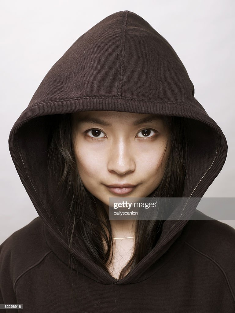 Young asian woman with hooded top : Stock Photo