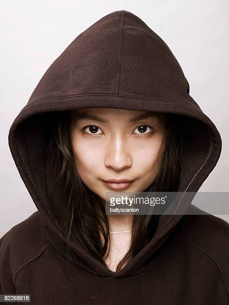 young asian woman with hooded top - hood clothing stock photos and pictures