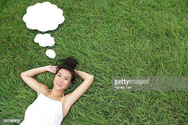 Young Asian woman with thought bubbles