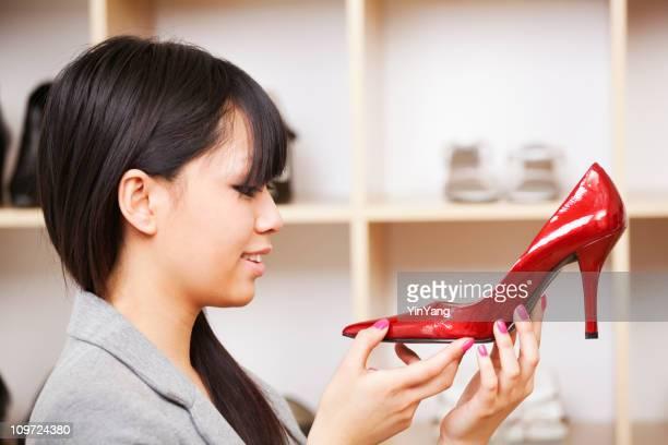 Young Asian Women Shoe Shopping in Retail Store, Holding Merchandise