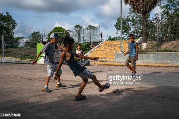 Young asylumseekers play close to the International Bridge near a section where a father and daughter drowned attempting to cross into the United...