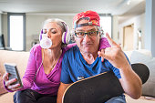 Young at heart grandparents series: Listening music and rock sign