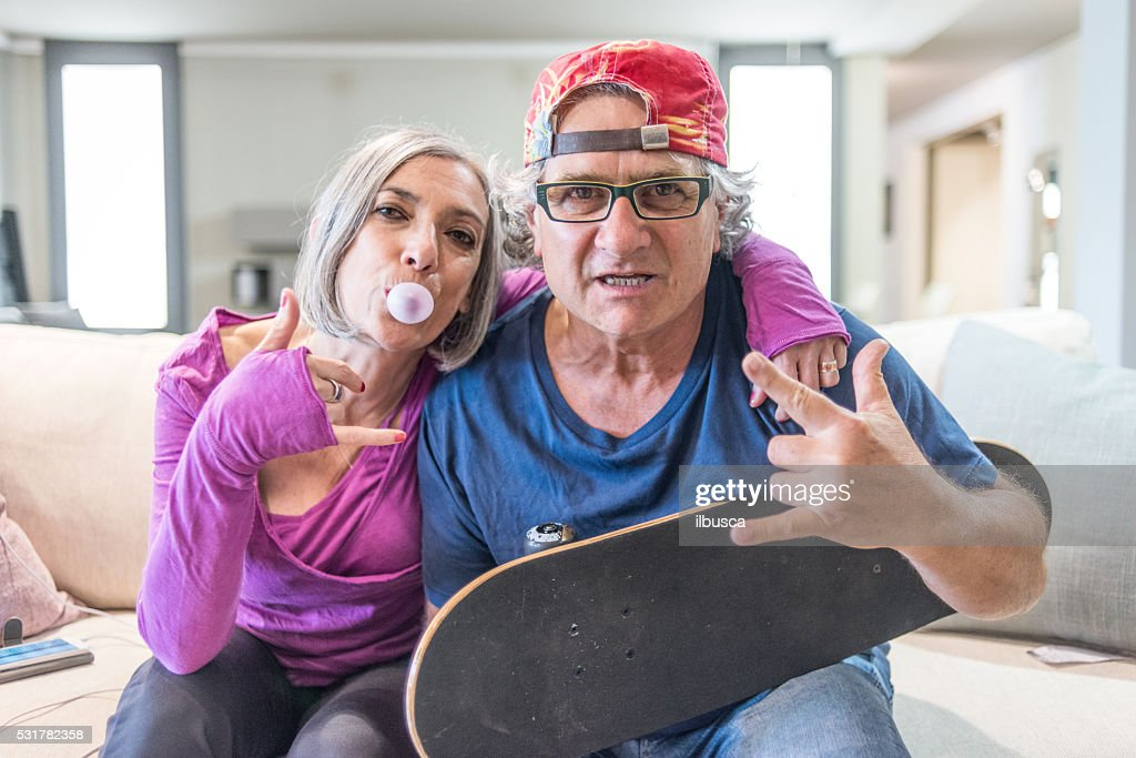 Young at heart grandparents series: Rock and roll sign : Stock Photo