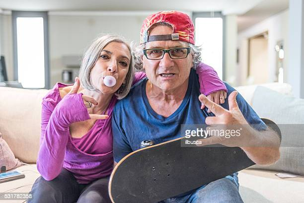 young at heart grandparents series: rock and roll sign - freaky couples stock photos and pictures
