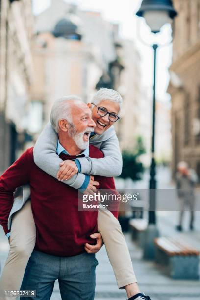 young at heart - piggyback stock pictures, royalty-free photos & images