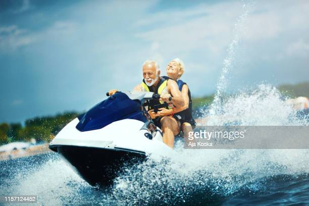 young at heart. - jet ski stock pictures, royalty-free photos & images