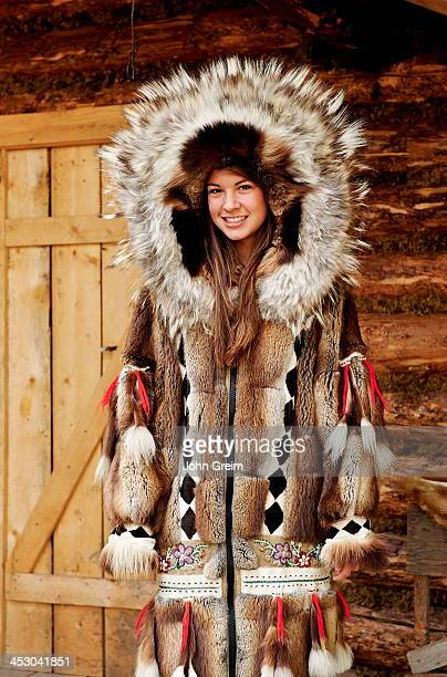 Young Athabascan woman modeling the traditional fur clothing of her native tribe