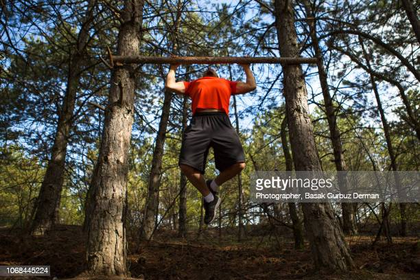 young athelete exercising outdoors - basak gurbuz derman stock photos and pictures