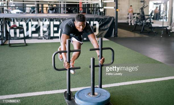 young athlete at sled training - forward athlete stock pictures, royalty-free photos & images