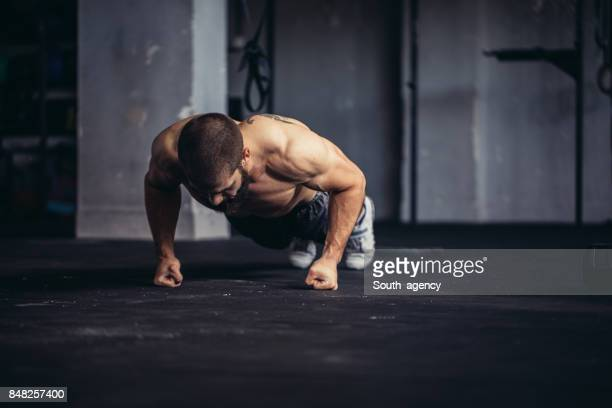 young athlete doing push-ups - push ups stock pictures, royalty-free photos & images