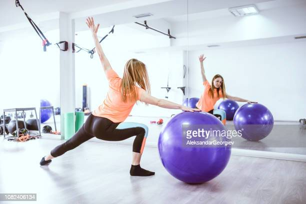 Young Athlete Female Practicing Pilates With Ball