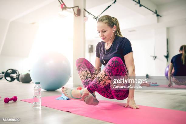 young athlete female practising yoga standing in scale exercise - aerobics stock photos and pictures