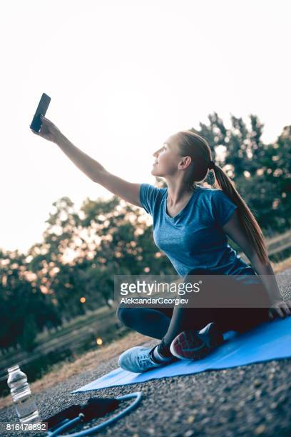 Young Athlete Female Taking Selfie After Successfully Finished Hard Training