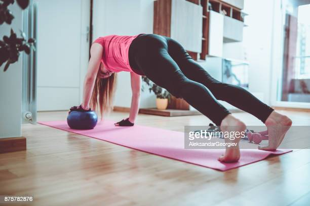 young athlete girl doing push ups at home in the morning - aleksandar georgiev stock photos and pictures