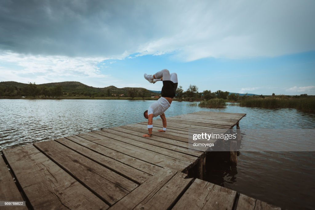 Young athlete having a hard training class by the lake : Stock Photo