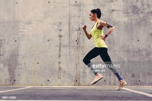 young athlete jogging outside - running stock pictures, royalty-free photos & images