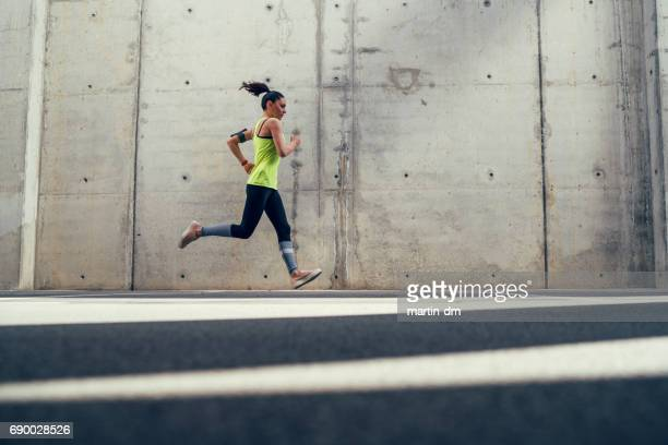 Young athlete jogging outside