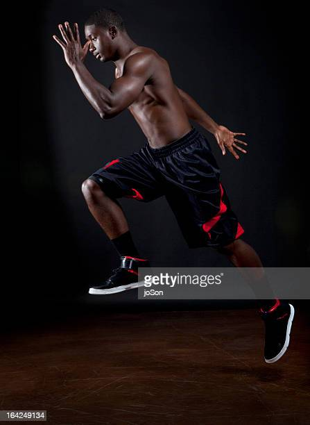 Young athlete male running in mid air