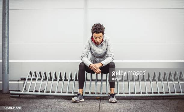 young athlete relaxing after the workout - center athlete stock pictures, royalty-free photos & images