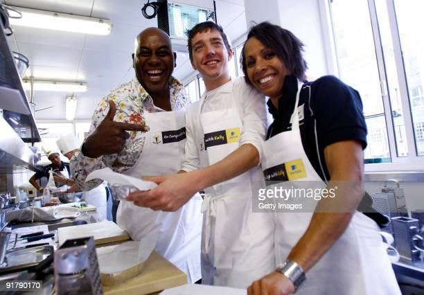 Young athlete Ross Murray in the kitchen with Dame Kelly Holmes and Ainsley Harriott during the Aviva On Camp with Kelly Cookery GetTogether on...