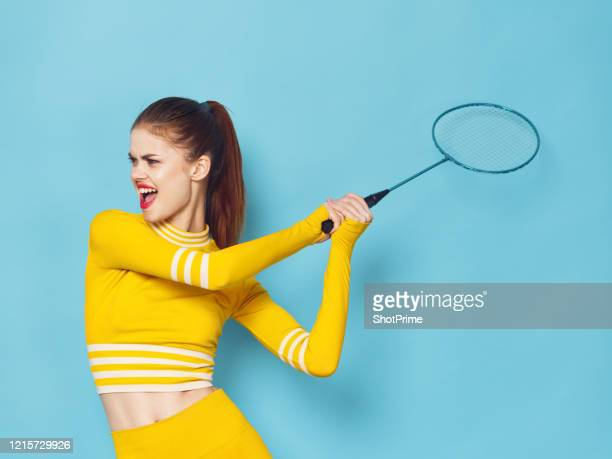 young athlete swung a badminton racket to repel a shuttlecock - championships stock pictures, royalty-free photos & images