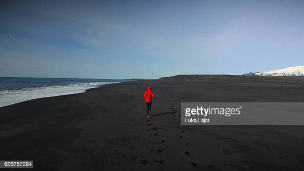 Young athlete woman running at the Iceland.
