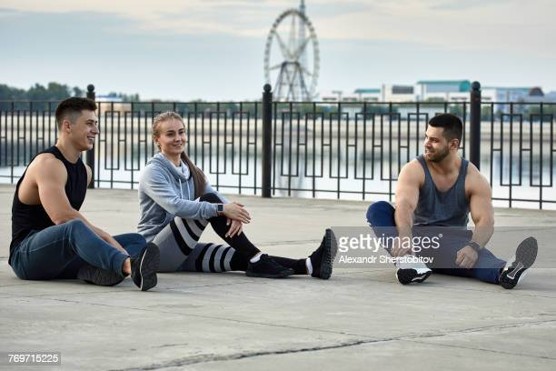 Young athletes resting on promenade, Blagoveshchensk, Amur, Russia