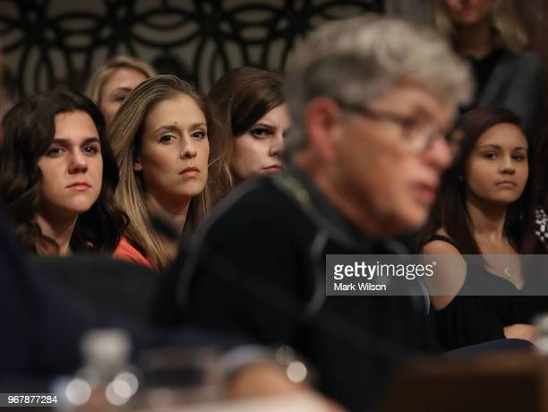 Young athletes watch as Lou Anna Simon former president of Michigan State University testifies during a Senate Commerce Science and Transportation...