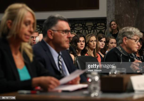 Young athletes watch as Rhonda Faehn former director of the USA Gymnastics Women's Program Steve Penny former president of USA Gymnastics and Lou...