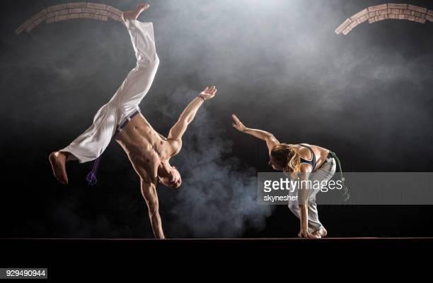 young athletic people exercising capoeira in a health club. - capoeira imagens e fotografias de stock