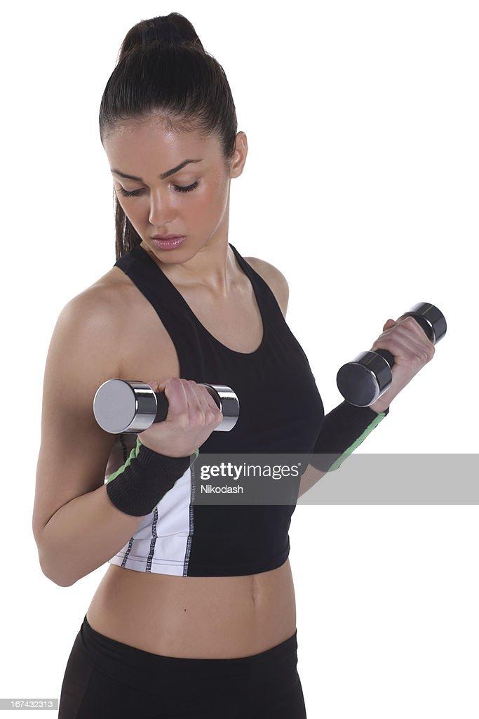 Atlético joven mujer haciendo ejercicios : Foto de stock