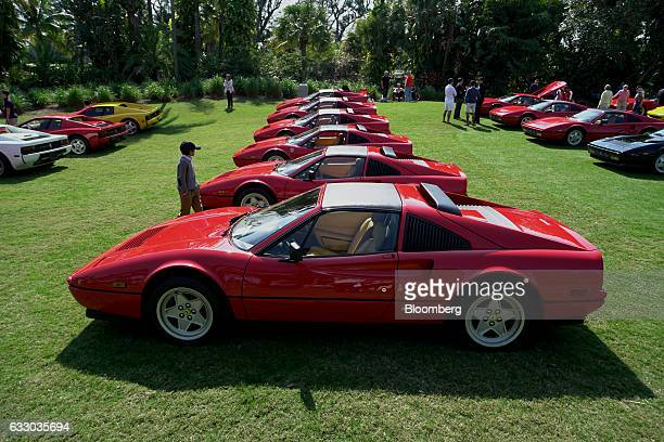 Young attendee walks past a display of 1980's Ferrari 328 GTS sports vehicles during the 26th Annual Cavallino Classic Event at the Breakers Hotel in...