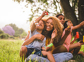Young attractive african american family blowing bubbles in the