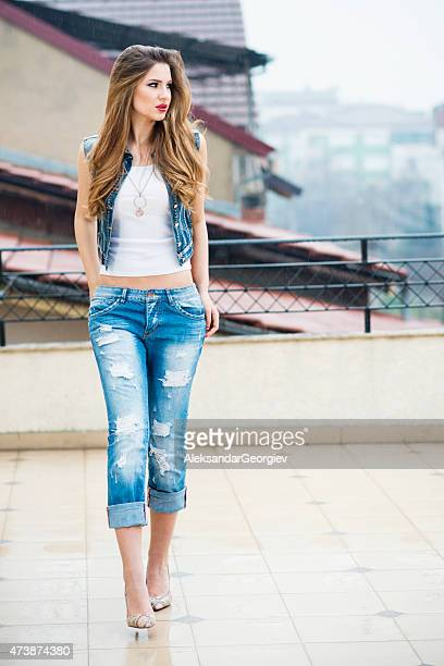 young attractive blonde woman walking under rain - wet t shirts stock pictures, royalty-free photos & images
