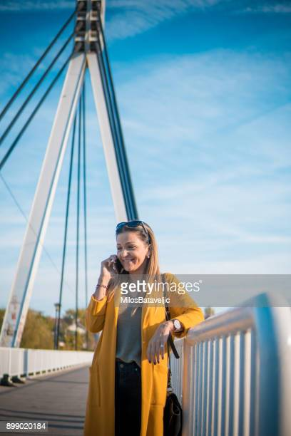 Young Attractive Businesswoman Talk and Take Selfie Photo With her Smart Phone
