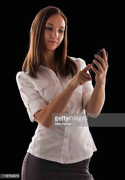 young attractive businesswoman text messaging - hair parting stock photos and pictures