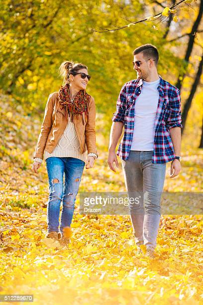 young attractive caucasian couple walking and loving in city park - drazen stock pictures, royalty-free photos & images