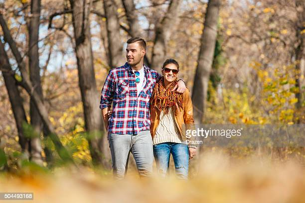 young attractive couple hugging and loving in nature in autumn - drazen stock pictures, royalty-free photos & images