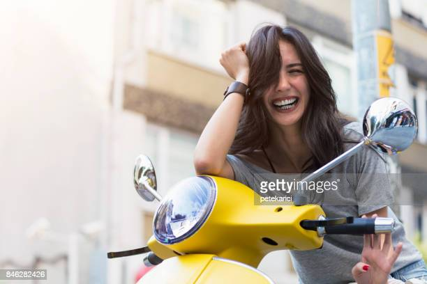young attractive girl and vintage old scoote - moped stock photos and pictures