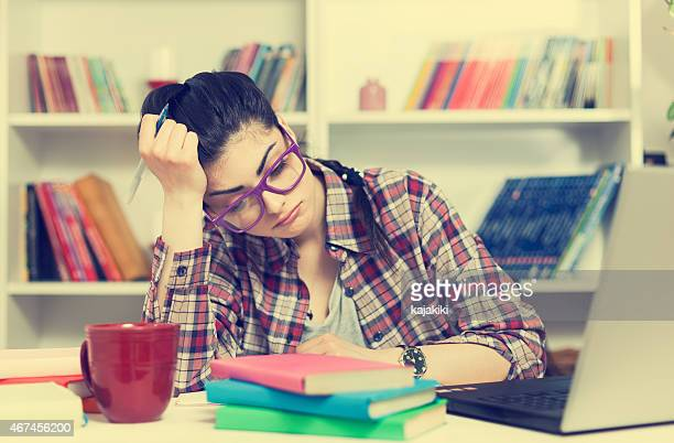 Young Attractive Girl with Glasses is bored