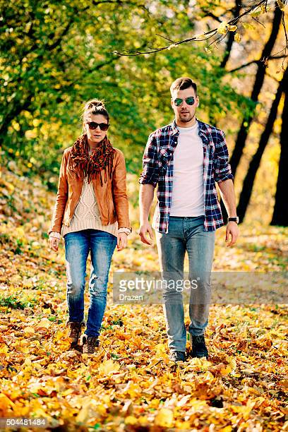 young attractive heterosexual couple hugging and loving in city park - drazen stock pictures, royalty-free photos & images