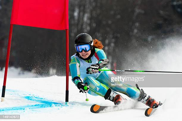 Young attractive woman at giant slalom race