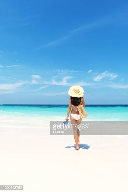 young attractive woman in bikini enjoying tropical beach and summer vacation - liu he stock pictures, royalty-free photos & images