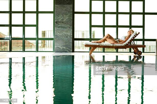 young attractive woman laying on the deck chair and relaxing. - hydrotherapy stock photos and pictures