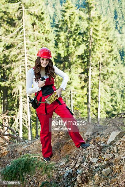 Young attractive woman manages forest works