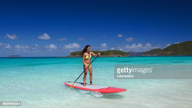 young attractive woman on paddleboard