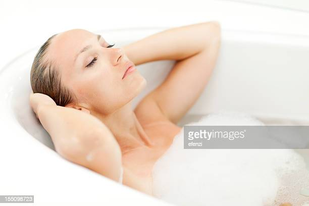 Young attractive woman relaxing in bathtub