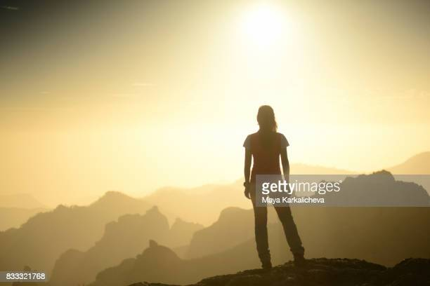 Young attractive woman standing on top of a mountain, Canary islands