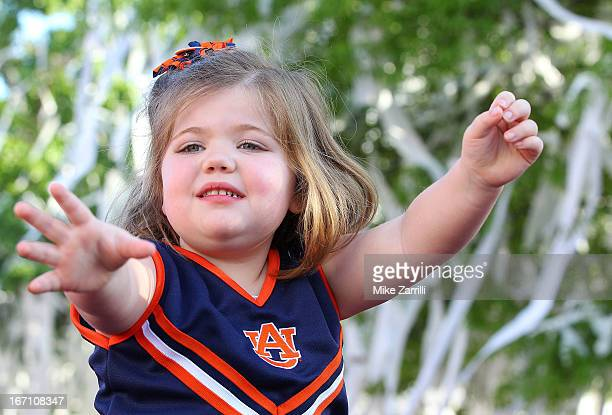 A young Auburn fan waits to catch a roll of toilet paper during the Auburn Oaks at Toomer's Corner Celebration on April 20 2013 in Auburn Alabama