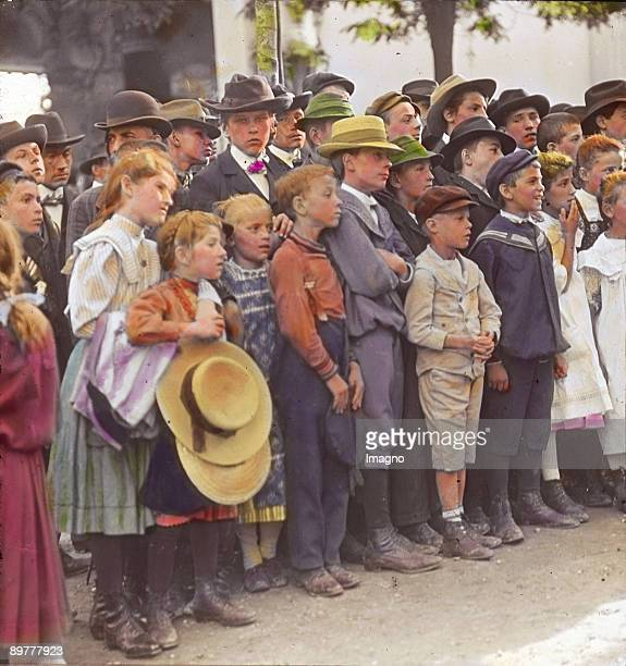 Young audience at the Wurstel theatre Vienna 2nd district Photograph by Emil Mayer Handcolored lantern slide Around 19051910